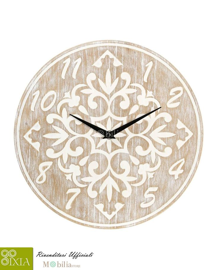 Fantastico Orologio da parete Naturale Ixia rotondo, realizzato in legno con numeri e particolarissime decorazioni etniche in bianco, le lancette nere vi indicheranno con stile lo scorrere del tempo. Scopri le nuovissime promozioni Ixia su Mobilia Store.