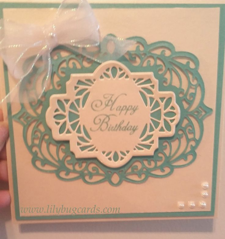 A birthday card done in white and turquoise