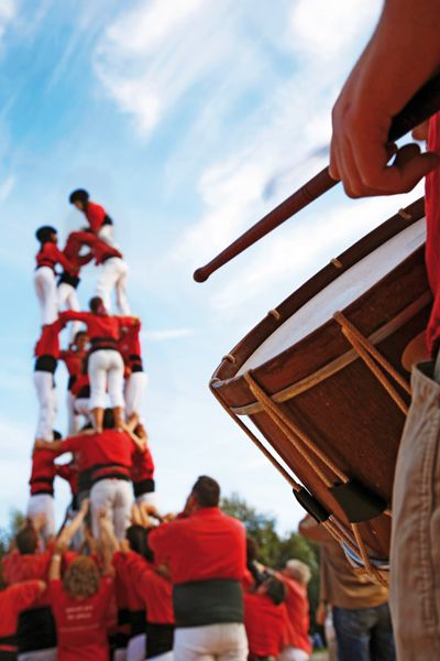 "One of Catalonia's most famous traditions is that of the ""castells"" (castles), which are human towers that are lifted by building different levels of people."