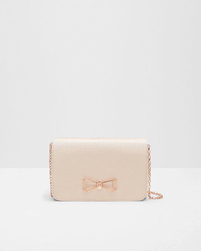 http://www.tedbaker.com/uk/Womens/Accessories/Bags/MICHALA-Geometric-bow-clutch-bag-Straw/p/131050-93-STRAW