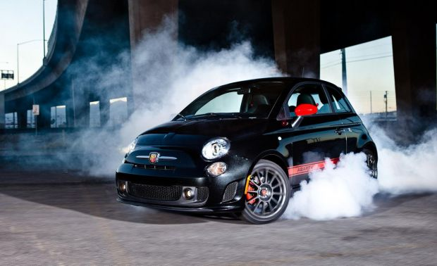 Fiat 500 Abarth with leather-trimmed black and red seats, sun roof, 31mpg, and a whole lot of awesome.