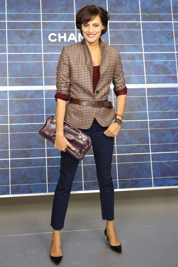 Her signature look: chic, tailored, accessoried & belted - over a jacket, under a jacket at her natural waistline, or over a tucked-in shirt and low-rise slacks | Ines de la Fressange Chanel 2013 show.