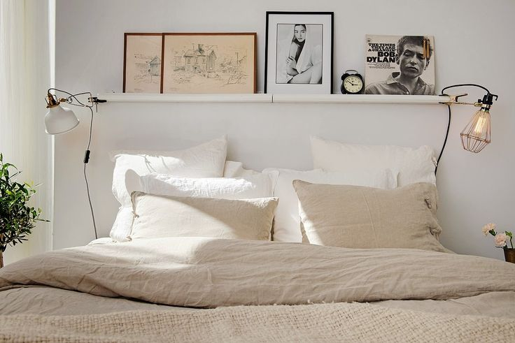 Swedish Bedroom. Love this layout and simplicity ... Natural beige and white mix fantastic ...above bed shelf done well