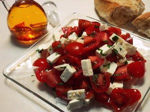 Mexican style...Cherry Tomato & Panela Cheese Salad w/ Chile de Arbol Infused Olive Oil