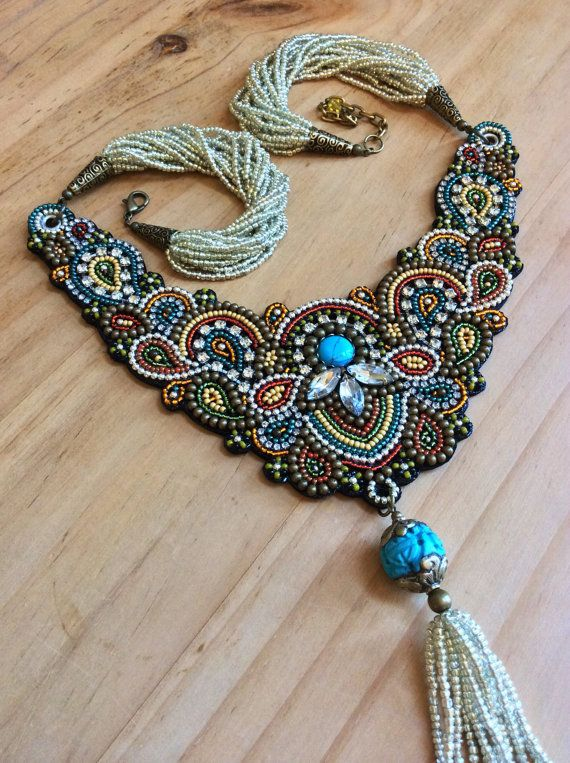 An elegant bead embroidered necklace featuring hundreds of glass seed beads in rich fall colors of teal, olive, red, rust, orange and mustard
