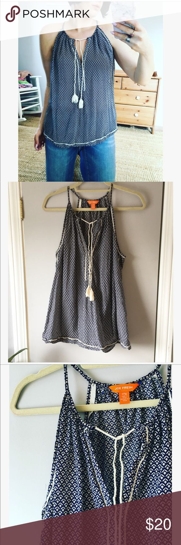 Joe Fresh navy blue and white tassel tank top Joe Fresh 100% cotten blue and white print  lightweight sleeveless top with tassel details. This is a perfect spring top! Would be cute with white denim and under a cardigan!   Make me an offer or add to a bundle for a private discount 😘 Joe Fresh Tops Tank Tops