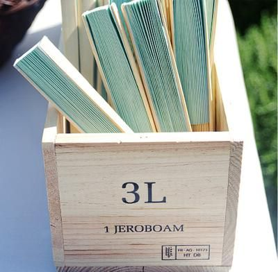 cute way to give out programs on a hot sunny beach wedding!