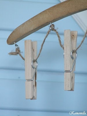 Close up of mitten dryer. Wooden hanger, eye screws, twine, & wooden clothes pins.  I Lilla Kamomillas Villa: Pyssel