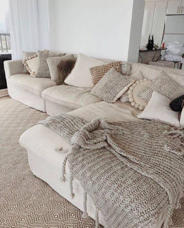 neutral sofa + nude pillows and throw