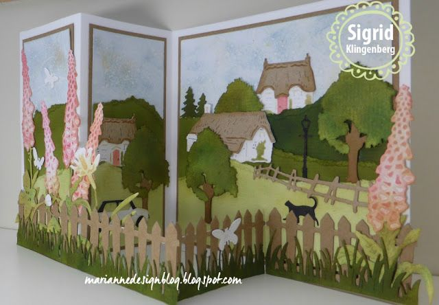 Handmade card by DT member Sigrid with among others Creatables Tiny's Cottages (LR0453), Tiny's Foxglove (LR0452), Tiny's Rose (LR0451), Tiny's Narcissus (LR0399), Collectables Village Decoration Set (COL1383) and Craftables Grass (CR1355) from Marianne Design