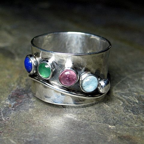 This mother's ring is one of my favorites.      If you are not a mother, it looks great with your favorite stones.  One of these days, I'm making one for myself with different shades of sapphire...