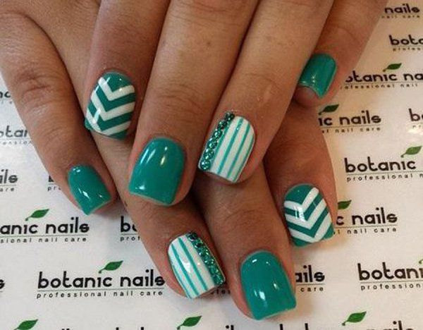 Dip your nails in teal with this fashionable looking nail art design. Combined with white and teal colored beads, the nails are coated in bold shapes and lines combined with matte coats to create a wonderful and fresh looking summer nail art ensemble you would love to have!