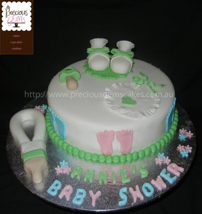 Baby shower cake with baby booties, dummy, bib and feeding bottle created by Precious Gems Cakes Cupcakes Cookies, Sydney - 0411 176 533