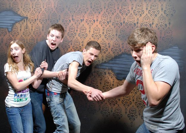 A whole page filled with pictures from the hidden camera at a haunted house! this is great.