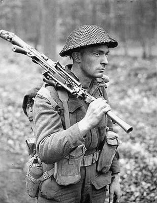 Private  DB MacDonald-Royal Canadian Regiment-Oct 1943 Campobasso Italy-holding Bren gun.
