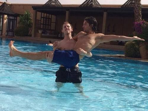 Robert Emms and Jack Donnelly in a swimming pool via Sarah Parish