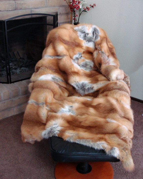 REAL red fox fur BLANKET. For curling up with a good book.