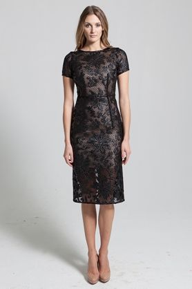 Black midi length floral lace coated mesh dress. The Hattie dress is a black floral coated mesh dress with a nude underdress. This midi length dress features a rounded neckline, shortsleeves and is designed as a slim fit. Overal this dress has a sophisticated yet sexy look.   #evening #blackmesh #blackfloralpattern #blackdress #nudeslip #nudeandblack #kneelengthdress #sophisticated #black #bold #fitted #NARCES