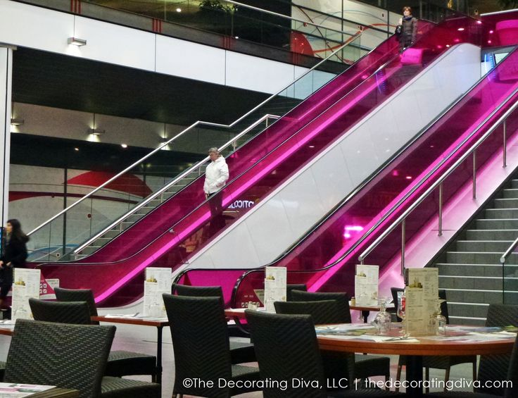 Electric pink (with purple undertones) escalators at the EuroLille Mall in Lille, France. Definitely a fun and different twist on escalators design that is memorable.