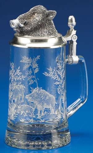 """Decorated with etched-style print of a wild boar. Starburst light-reflecting pattern on the bottom. This piece is topped with a raised wild boar pewter lid.    Material: Glassware  Origin: Germany  Volume: .40L  Dimensions: 8-1/4"""""""