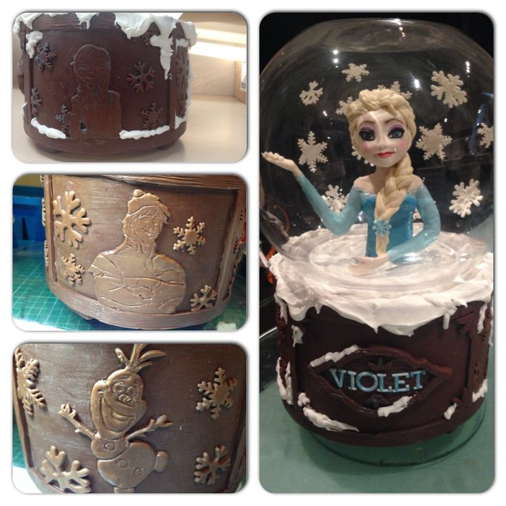 "This is my Frozen the movie cake with Elsa in the snow globe and Olaf, Anna and kristoff ""carved"" into ""wooden"" base. Really happy with the way this turned out"