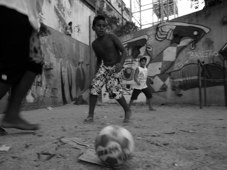 Youth's Passion for Football in Brazil - CAT IN WATER