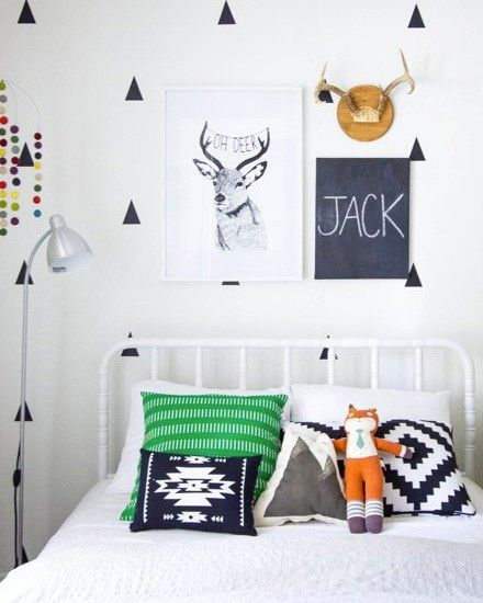 This boys room is clean and classic. Socks looks like he's enjoying hanging out on the bed.