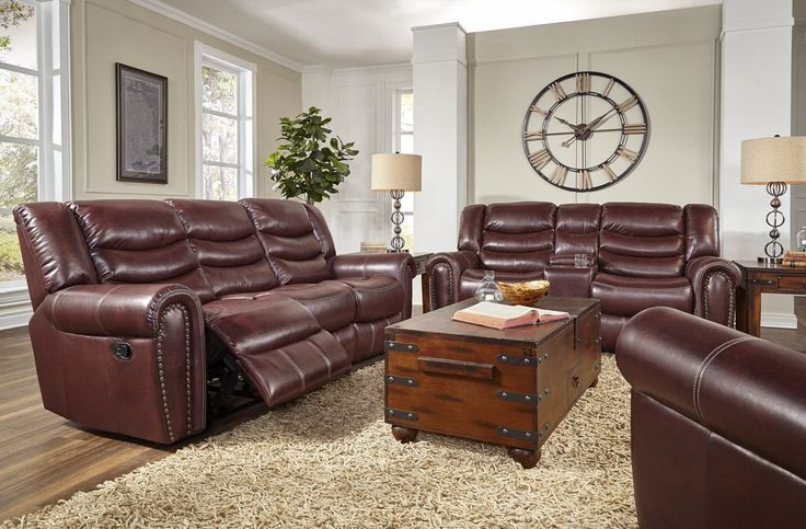 Nail Head Accent Chocolate Bonded Leather Reclining Living Room Set By Corinthian  Sofa has Recliners at both ends  Double Recliner Love Seat with console Storage and cup holders  Sofa And Love Seat $1399.00   Recliner Chair Available $399.00             When you add it to the group   OAK 65503