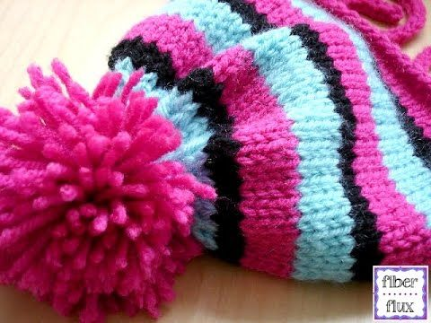 Learn How To Attach A Pom Pom To A Hat With This Easy