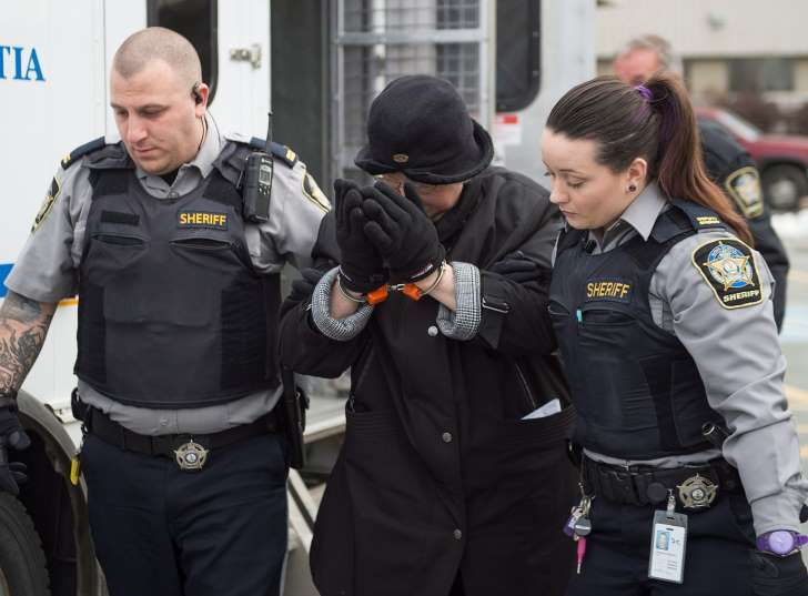 Melissa Ann Shepard, known as the Internet Black Widow, arrives at court in Dartmouth, Canada on Tuesday, March 15, 2016.
