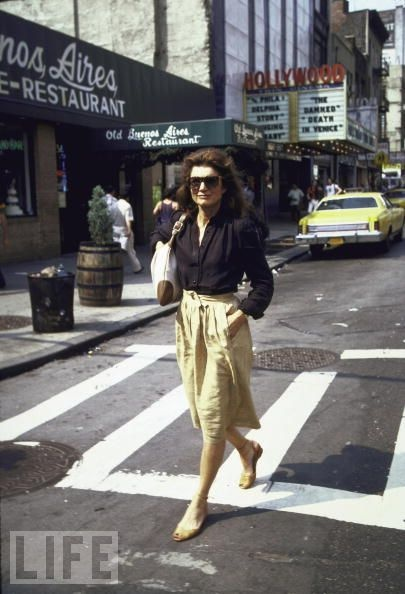 """Jackie Kennedy Onassis crosses a street in 1981. She died in 1994 at age 64. """"My mother died surrounded by her friends and her family and her books, and the people and the things that she loved. She did it in her own way, and on her own terms, and we all feel lucky for that,"""" John Jr. said."""