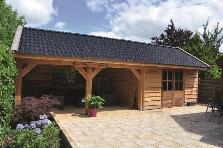 Moderne Remise mit Gartenhaus und Terrasse aus ...