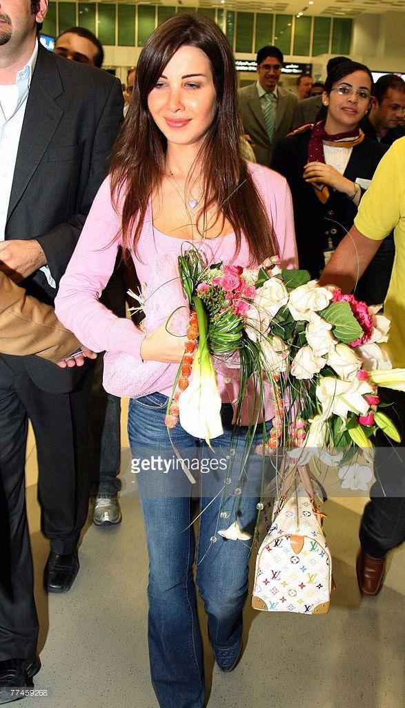 Lebanese singer Nancy Ajram arrives at Doha Airport, 23 October 2007.