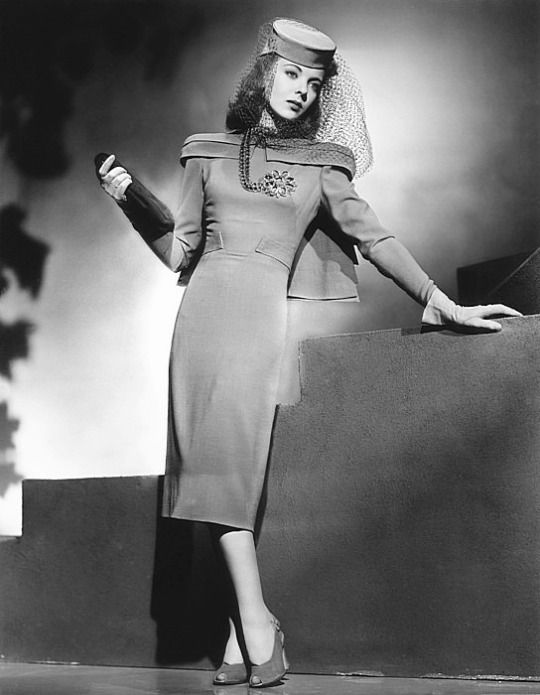 Ida Lupino models one of the dresses designed by Milo Anderson for her film They Drive By Night, 1940