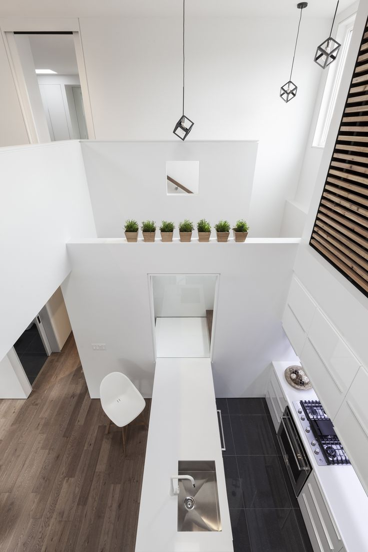 rzlbd > Flipped House > Void, staircase, kitchen #rzlbd