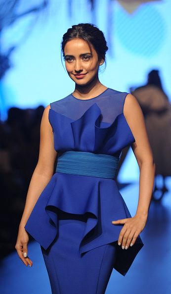 Indian Bollywood actress Neha Sharma poses for a photograph during Lakmé Fashion Week Summer Resort 2017 in Mumbai on late Februsry 1 2017 / AFP /...