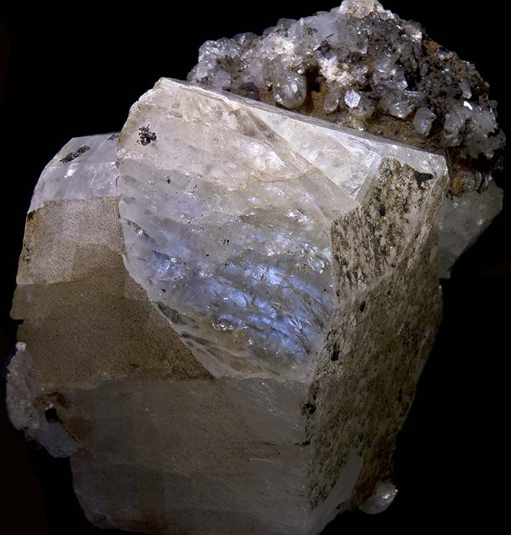 Rough moonstone showing adularescence - great guide to moonstone