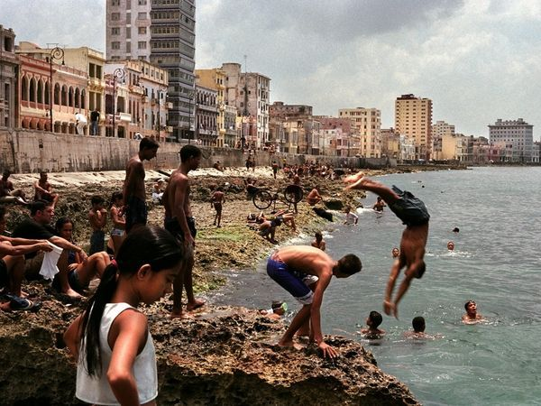 Swimming and diving at Havana's waterfront, Malecón. Photograph by Luca Nizzoli Toetti/Getty Images