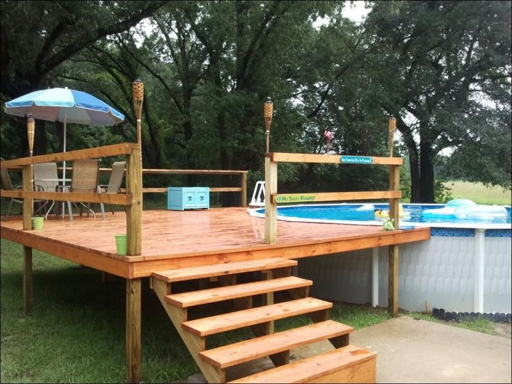 swimming pool wooden deck with simple design applied close to plastic pool with above ground
