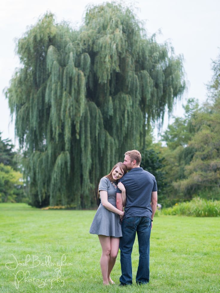Niagara Park's Botanical Gardens has the most romantic Weeping Willow Tree that is amazing for pictures! This cute couple's Niagara Falls Engagement photos turned out Stunning! #JoshBellinghamPhotography