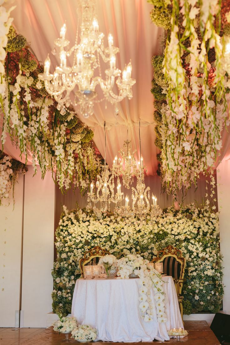 ROLENE STRAUSS & D'NIEL STRAUSS WEDDING | LOURENSFORD WINE ESTATE | South Africa  Coordinated by The Aleit Group  Photo by Vivid Blue Photography Venue: Laurent Hanging florals by Okasie Flowers