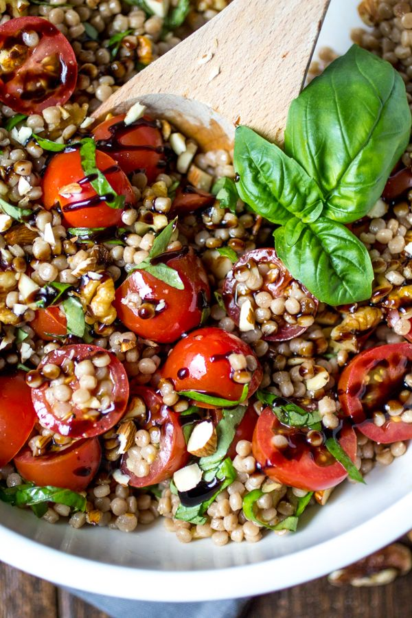 Tomato Basil Pearl Couscous Salad | In this recipe, chilled couscous is coated in a simple olive oil dressing, then tossed with tomatoes, basil, and almonds before being finished with a generous drizzle of balsamic glaze. Healthy and delicious! @wanderlustkitch