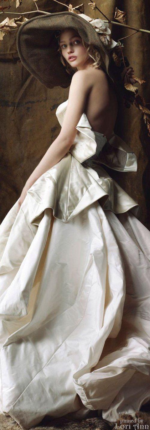 Model: Sasha Pivovarova wearing Vivienne Westwood for British Vogue December 2007 by photographer: Mario Testino