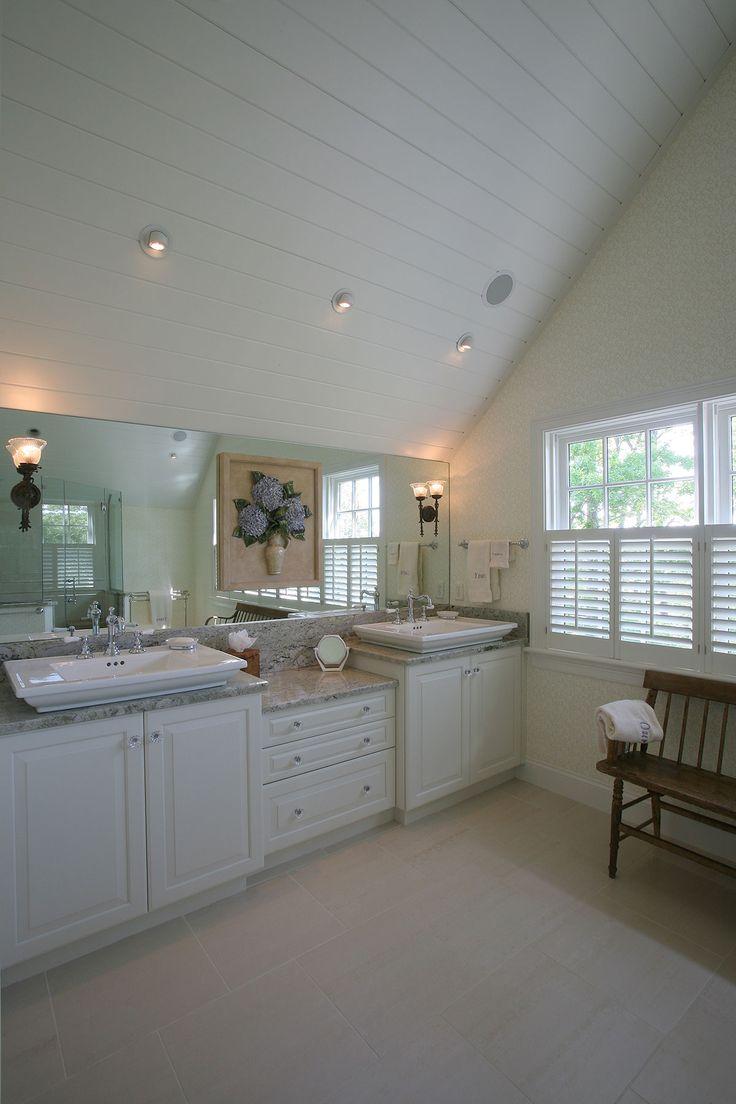 Cape Cod custom built bathroom with bead board ceilings, double vanity tile floors, and light color scheme. By Cape Associates, Inc.
