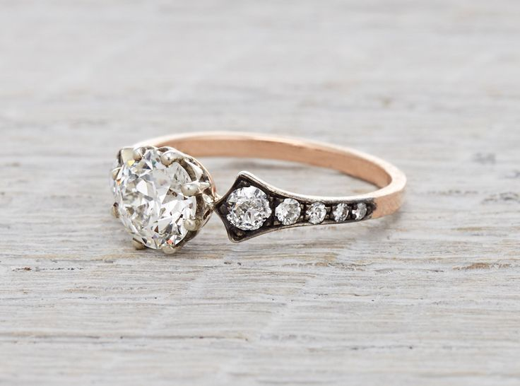 Engagement ring made of 18k rose gold, platinum and black rhodium and centered with a 1.02 carat GIA certified old European cut diamond with J color and VS2 clarity. Accented with .36 carats of single