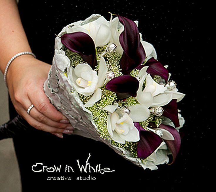 Wedding bouquet. Calla, orchid, gypsophila and wedding pins