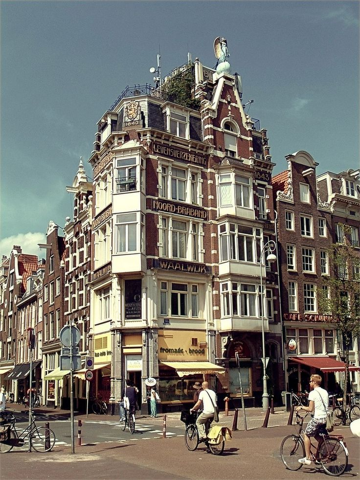 Amsterdam. The corner of the Singel & the Haarlemmerstraat is watched over by the arch angel Gabriel