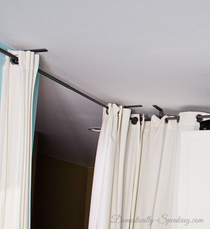 How to Turn a Bonus Room into a Bedroom - curtain rods on the ceiling