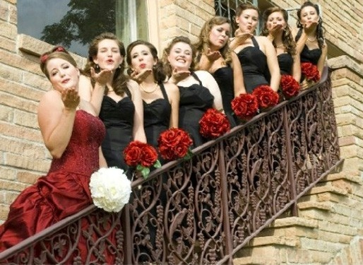 Red wedding dress, black bridesmaids gowns. Brides don't have to be in white/ivory anymore.