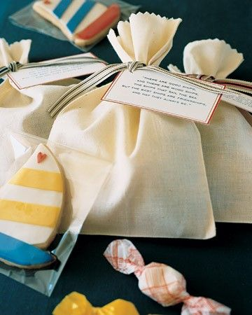 The favor is a muslin pouch filled with sailboat-shaped sugar cookies and saltwater taffy; it's tied with grosgrain ribbon, and an Irish toast to friendship is printed on a tag.